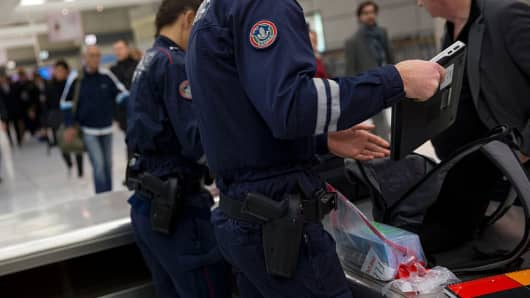 A file photo of French customs officers checking luggage at the the Roissy-Charles-de-Gaulle airport.