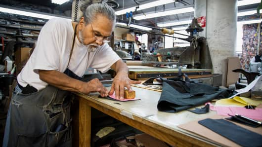 Roy Campos, owner of Justin Paul, works on a handbag at the company's manufacturing facility in Brooklyn, New York.
