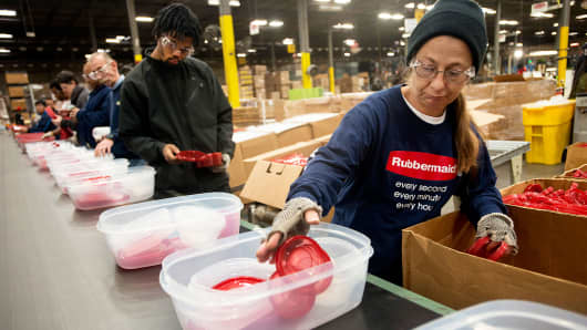 Employees assemble food containers on a production line at the Newell Rubbermaid factory in Mogadore, Ohio.