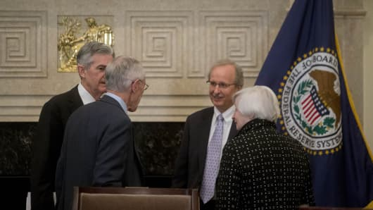 Janet Yellen, chair of the U.S. Federal Reserve, from right. Scott Alvarez, general council with the U.S. Federal Reserve, Stanley Fischer, vice chairman of the U.S. Federal Reserve, and Jerome Powell, governor of the U.S. Federal Reserve, talk after a meeting of the Board of Governors of the Federal Reserve in Washington, D.C.