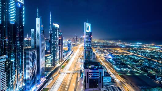 Elevated cityscape of Dubai illuminated at night