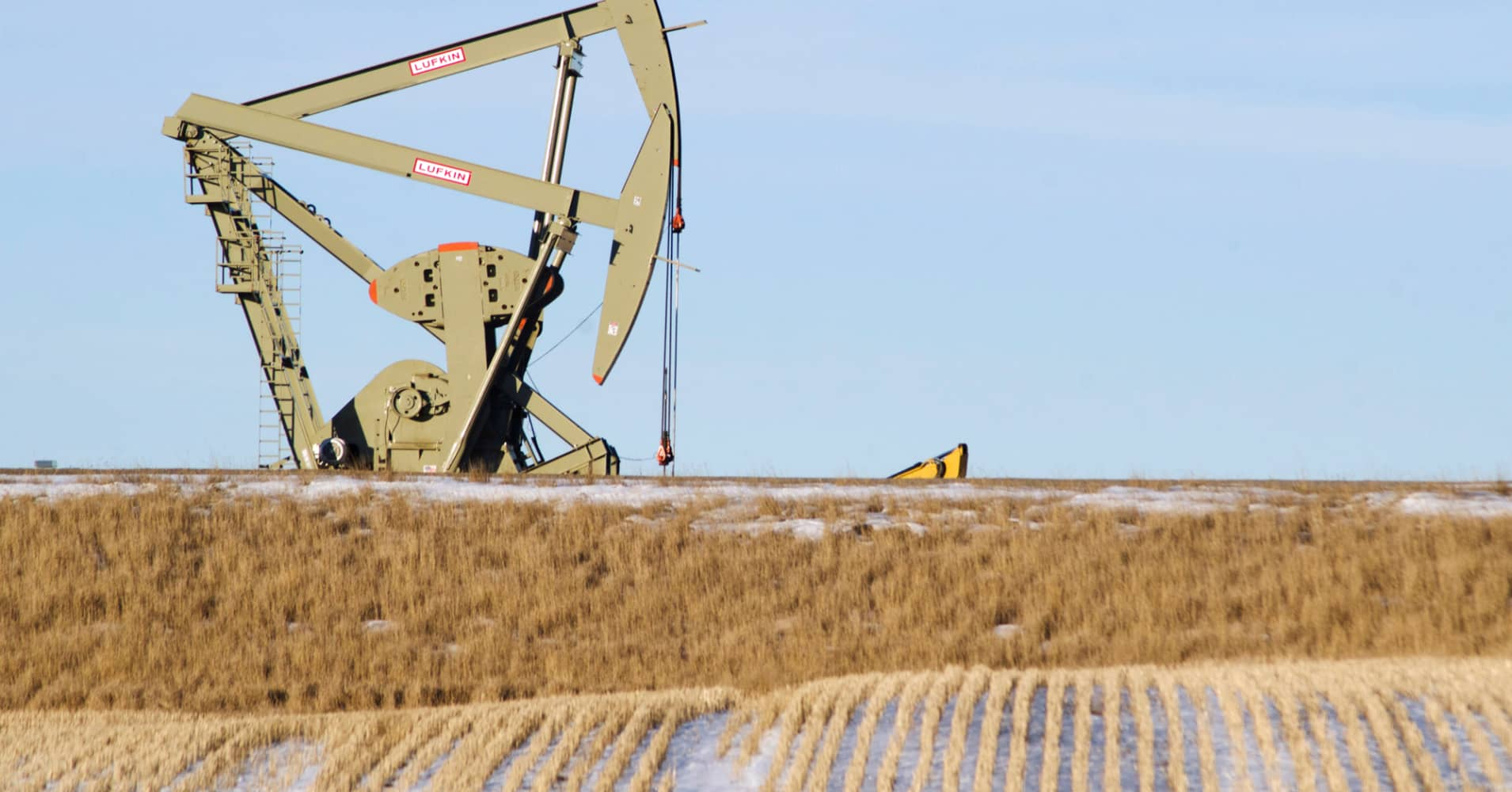 Oil prices slip, but hold near recent highs