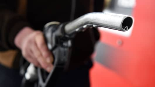 A man prepares to put fuel in his van at a filling station.