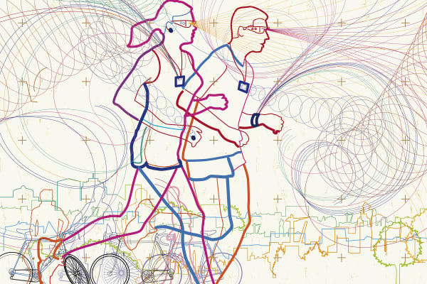 Man and woman running together in city