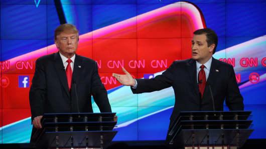 Republican presidential candidate U.S. Sen. Ted Cruz (R-TX) (R)speaks as Donald Trumplistens during the CNN Republican presidential debate on December 15, 2015 in Las Vegas, Nevada.