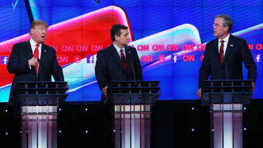 Republican presidential candidates Donald Trump (L) and Jeb Bush (R) respond to each other as U.S. Sen. Ted Cruz (R-TX) listens during the CNN debate on Dec. 15, 2015 in Las Vegas.