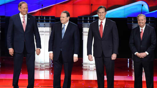 (L-R) Republican Presidential candidates George Pataki, Mike Huckabee,Rick Santorum, and Lindsey Graham pose for a photo before the start of the under card Republican Presidential debate ,at The Venetian hotel in Las Vegas,Nevada on December 15, 2015.