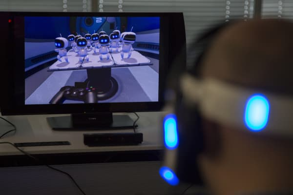 A member of the media plays a video game using a Sony Computer Entertainment Inc. Project Morpheus virtual-reality headset during a demonstration
