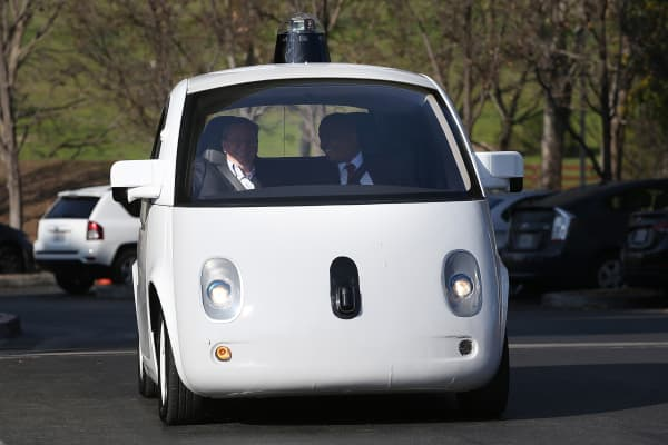 Transportation Secretary Anthony Foxx (R) and Google Chairman Eric Schmidt ride in a Google self-driving car at the Google headquarters on February 2, 2015 in Mountain View, California.