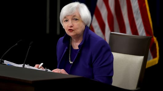 Federal Reserve Chairman Janet Yellen answers a reporter's question during a news conference in Washington December 16, 2015.