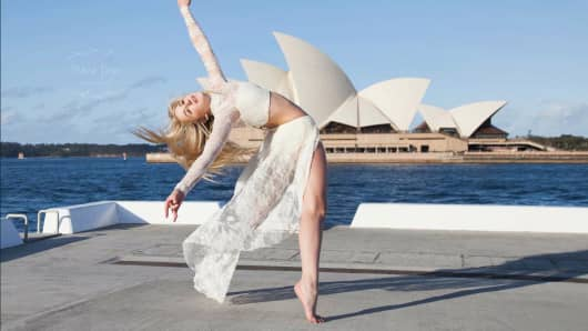 Chloe Lukasiak dancing at Sydney Harbor in front of the Sydney Opera House.