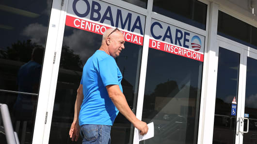 A man walks out of the Univista Insurance company office after shopping for a health plan under the Affordable Care Act, on December 15, 2015, in Miami.