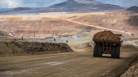 A dump truck hauls soil away from a pit at the Yanacocha gold mine in Cajamarca, Peru.