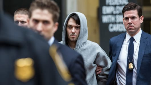 Martin Shkreli, CEO of Turing Pharmaceutical, is brought out of 26 Federal Plaza by law enforcement officials after being arrested for securities fraud on Dec. 17, 2015, in New York City.