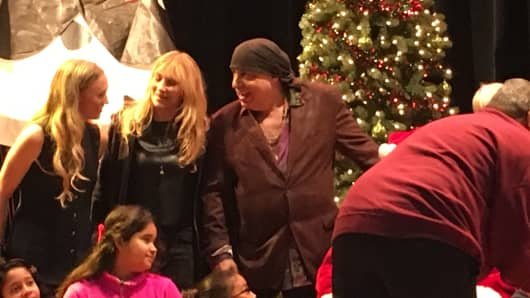 Actor and E Street Band guitarist Steven Van Zandt, left, and wife Maureen were on hand Dec. 14 to help Santa Claus distribute toys to the children at the Kips Bay Boys & Girls Club in the Bronx, New York.