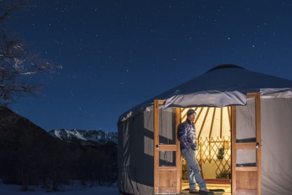 A man watching the stars while camping in a yurt below the La Plata Mountains in Mayday, Colorado.