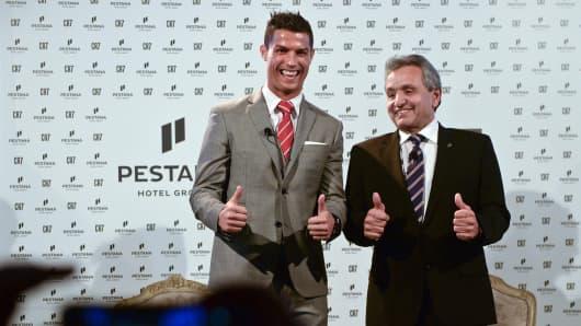 Cristiano Ronaldo (L) and CEO of Pestana hotel group, Dionisio Pestana, at Pestana Hotel Palace in Lisbon on December 17, 2015.