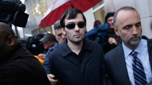 Martin Shkreli, center, leaves the courthouse after his arraignment in New York, Thursday, Dec. 17, 2015.