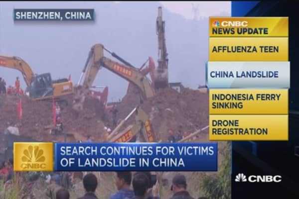 CNBC update: Search crews look for China landslide survivors