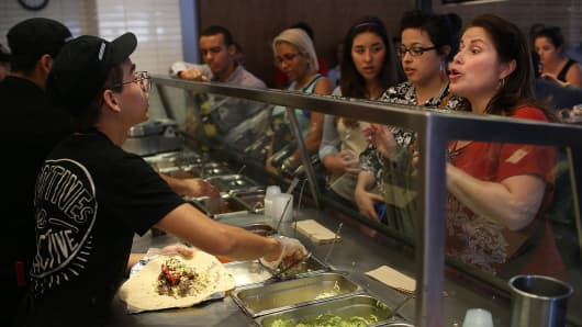 Chipotle restaurant workers fill orders for customers in Miami, Florida.