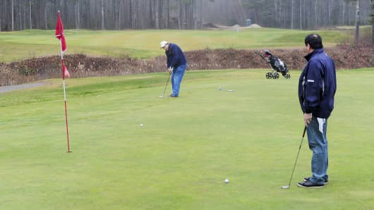 Danny Valliere, right, and Bob Small play the 12th hole at Nonesuch River Golf Course in Scarborough, Maine, on Dec. 14, 2015.