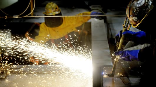Welders work on a beam
