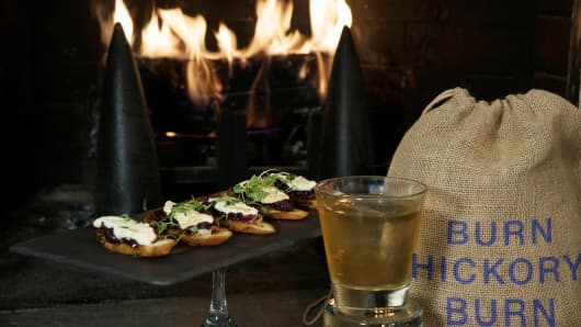 The Hickory Wood Sachet is served with Prosciutto & Ricotta Crostini with hickory smoked cranberries, and a hickory old fashioned.