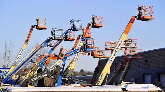 A group of multi-colored lifts at United Rentals.