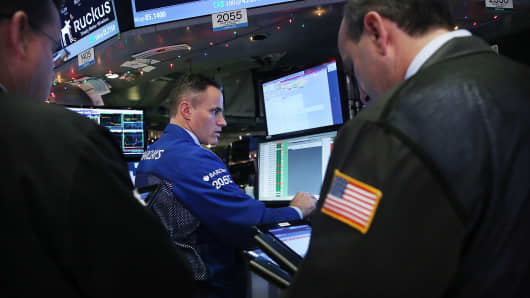 NYSE Trader looking a screens
