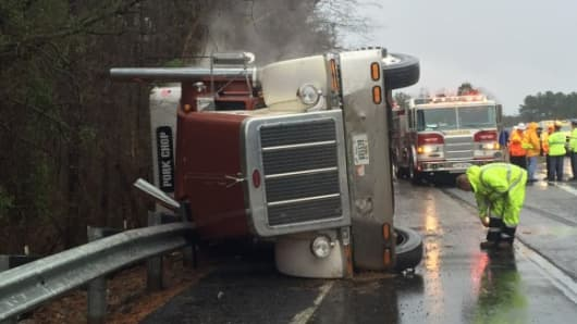 An overturned tractor trailer containing 2,600 pigs was assisted by emergency crews.