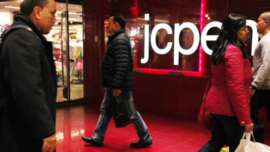 Pedestrians pass a JC Penney store in New York.