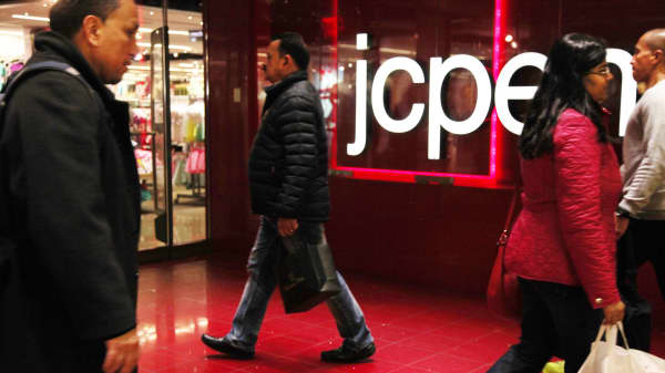 Pedestrians pass a JC Penney store in New York.
