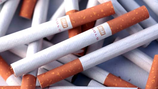 A pile of Benson & Hedges Gold cigarettes, produced by British American Tobacco Plc.