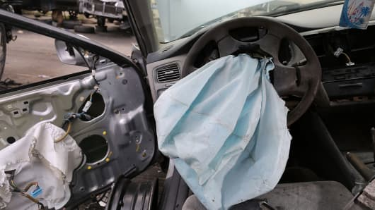 A deployed airbag is seen in a 2001 Honda Accord at the LKQ Pick Your Part salvage yard on May 22, 2015 in Medley, Florida. The largest automotive recall in history centers around the defective Takata Corp. air bags that are found in millions of vehicles that are manufactured by BMW, Chrysler, Daimler Trucks, Ford, General Motors, Honda, Mazda, Mitsubishi, Nissan, Subaru and Toyota. (