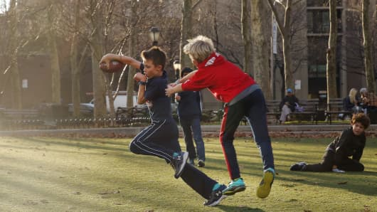 Young boys play in a park on an unusually warm winter day in Brooklyn, New York, earlier this month.