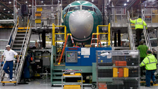 Boeing employees march up and down stairs entering and exiting Boeing 737 MAX during a media tour of the Boeing 737 MAX at the Boeing plant in Renton, Washington.