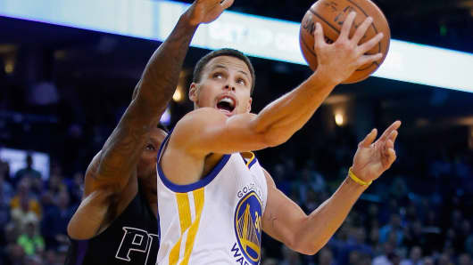 Stephen Curry of the Golden State Warriors in action against the Phoenix Suns in Oakland.
