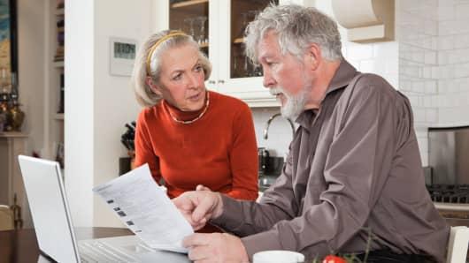 Senior couple paperwork