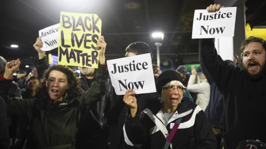Black Lives Matter protesters chant slogans at the Mall of America light rail station in Bloomington, Minnesota December 23, 2015.