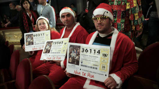 """People dressed in costumes attend the draw of Spain's Christmas Lottery """"El Gordo"""" (The Fat One) in Madrid, Spain, December 22, 2015."""