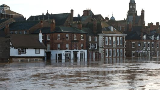 Flooded properties are pictured after the adjacent River Ouse burst it's banks in York, northern England, on December 27, 2015.