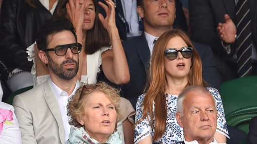 Sacha Baron Cohen and Isla Fisher attend Wimbledon in 2015.