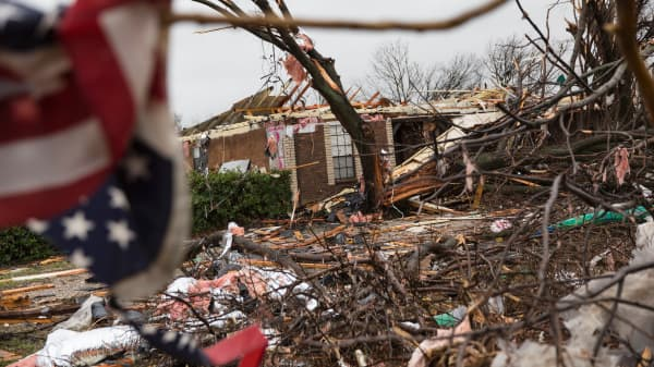 An American flag placed by first responders is seen December 27, 2015 in the aftermath of a tornado in Rowlett, Texas. At least 11 people lost their lives as tornadoes tore through Texas, authorities said, as they searched home to home for possible more victims of the freak storms lashing the southern United States.