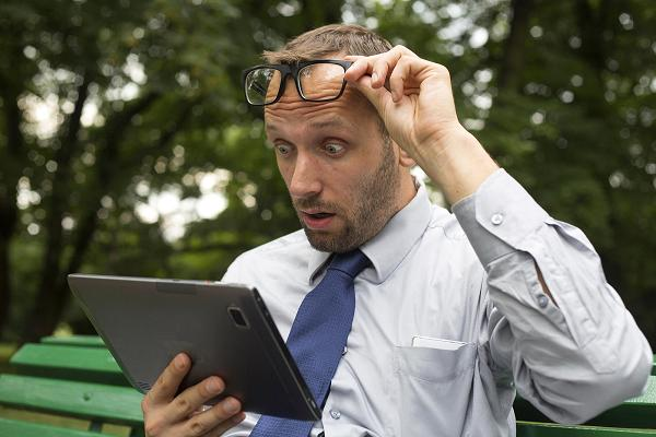 Business man reading news on tablet