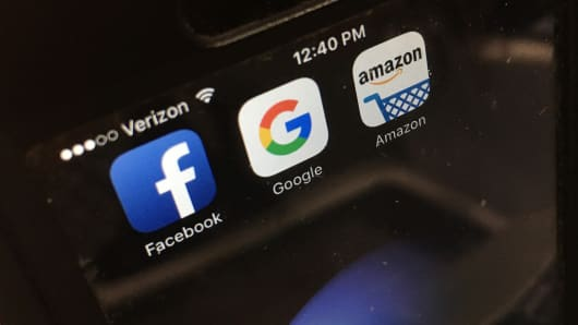 Facebook, Google and Amazon apps displayed on a smartphone.