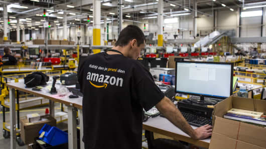 An employee uses a computer to process customer orders in the shipping zone of the new Amazon.Com Inc. fulfillment center on its opening day in Dobroviz, Czech Republic