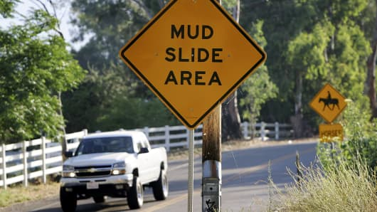 Signs warn of mud slides in Devore, when the area was hit by floods in 2006.