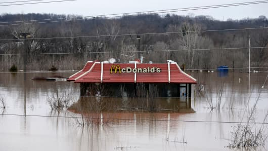 Floodwater from the Bourbeuse River surrounds a McDonald's restaurant, Tuesday, Dec. 29, 2015, in Union, Mo.
