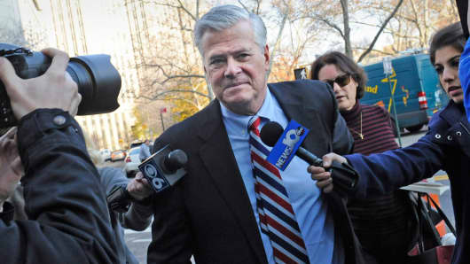 Former New York Senate Majority Leader Dean Skelos, center, arrives at federal court in New York, Dec. 11, 2015.