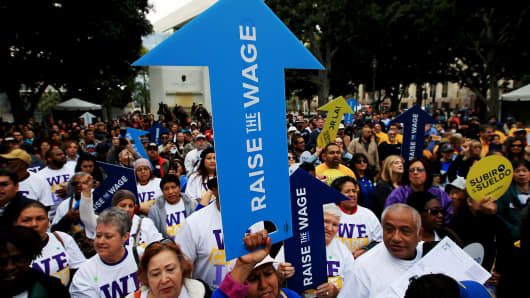 A coalition of workers, businesspeople and civic leaders rally outside Los Angeles City Hall on Friday, Jan. 30, 2015, to urge the city council to act without delay to increase the minimum wage and improve the lives of nearly 800,000 L.A. residents.